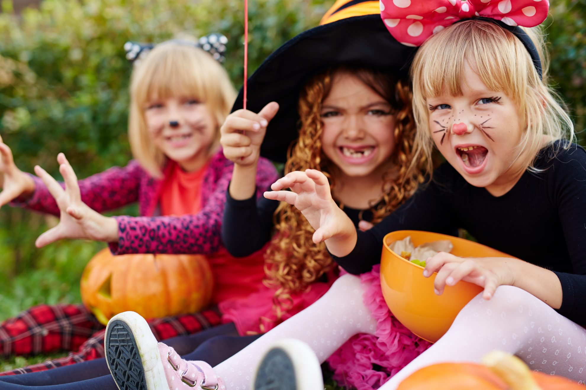 Little girls all dressed up for Halloween. Here's Where Kids Can Eat Free on Halloween.