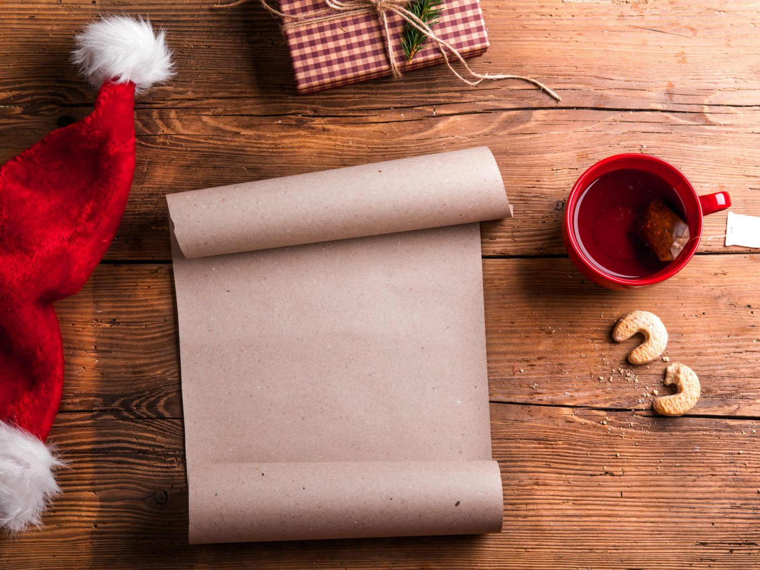 making a list for christmas on wooden background