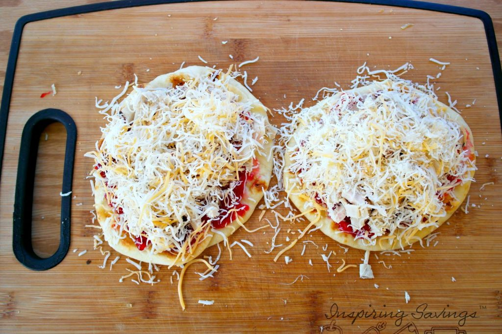 Adding cheese to Cranberry turkey Flatbread