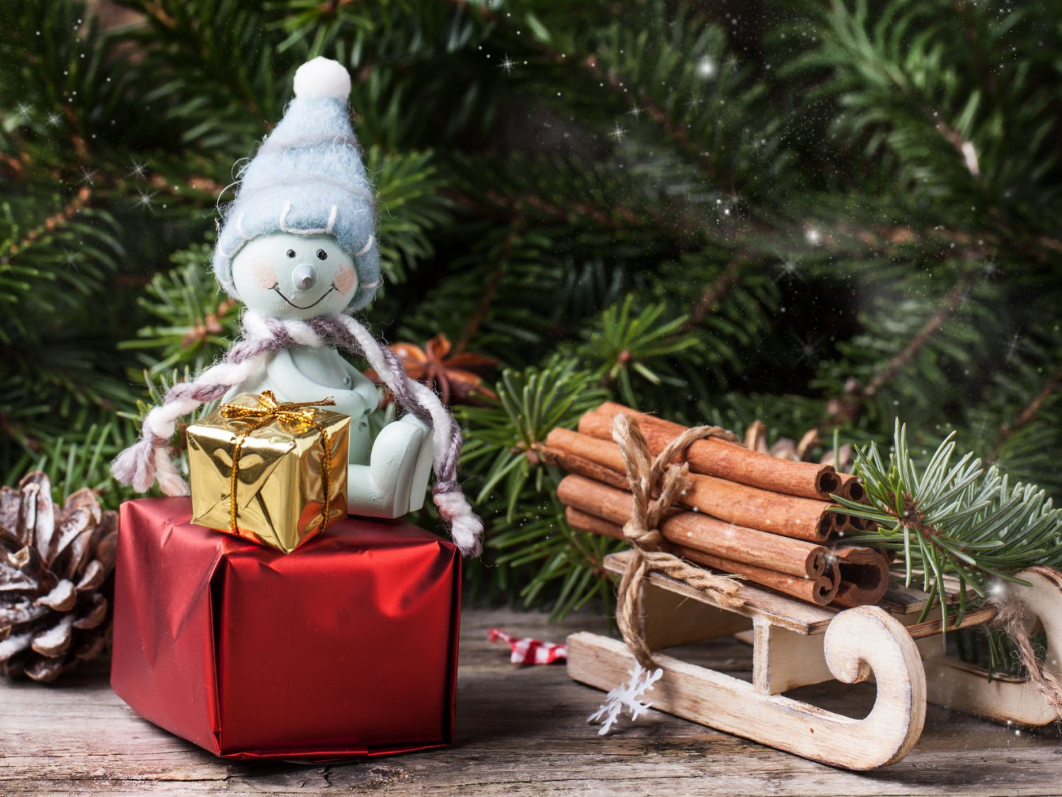 Small package containing gift card for Christmas present. With Snowman.