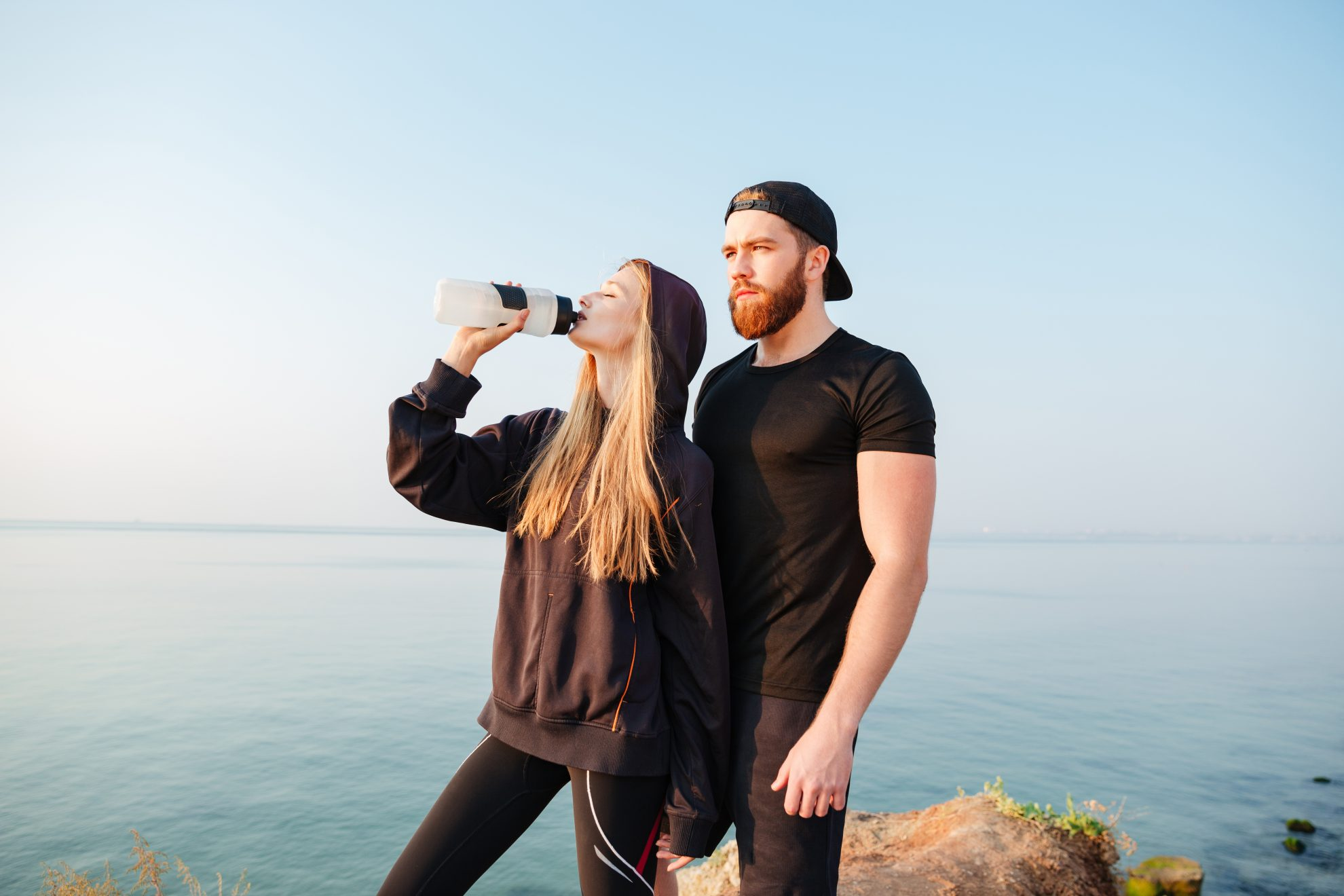 couple hiking - reusable water bottle - gifts that save money