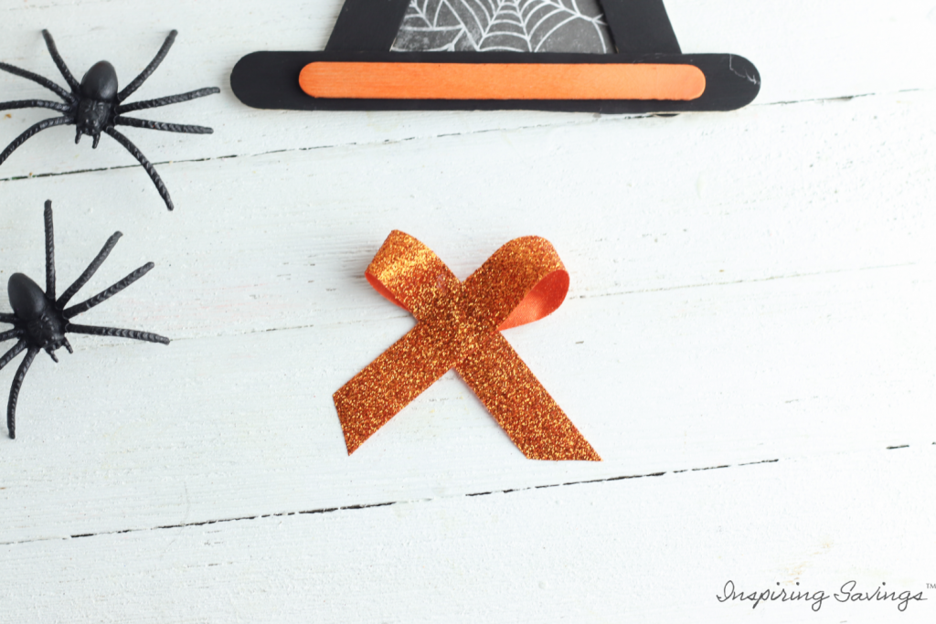 making bow out of orange ribbon