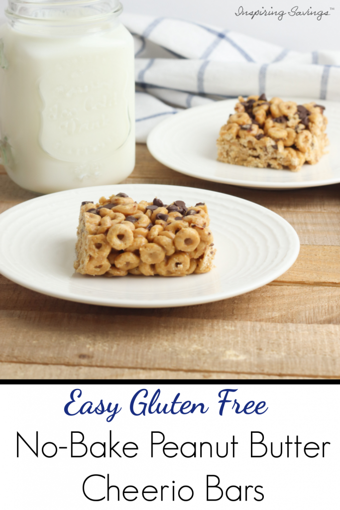 On white place gluten free peanut butter cheerio bar with mason jar glass of milk.