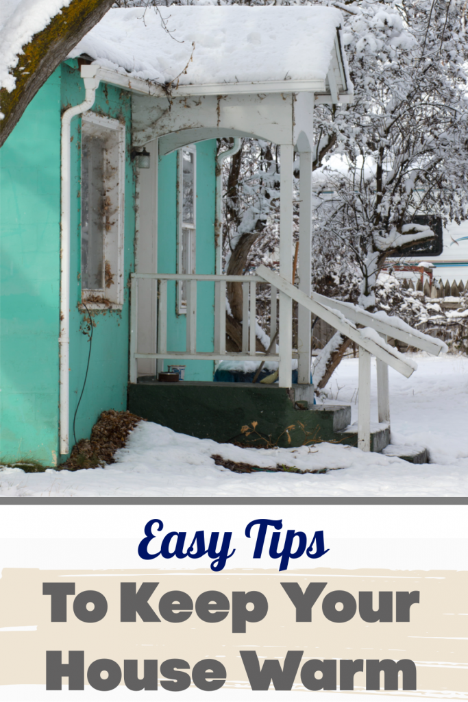 Front porch of home surround by snow - Tips to keep your house warm