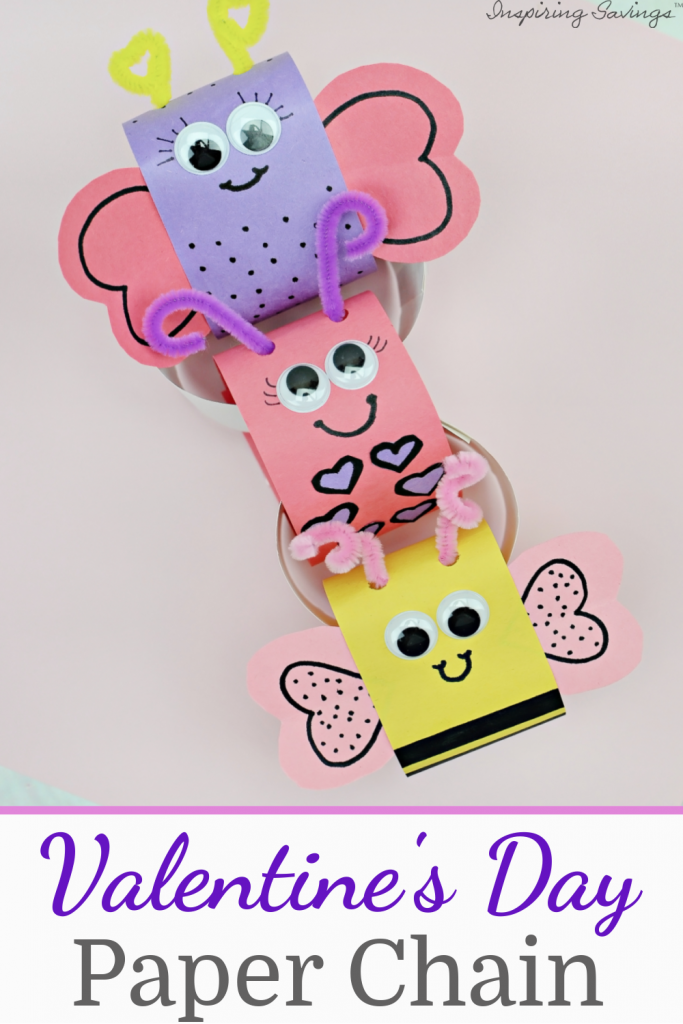 valentine's day paper chain bugs on pink background