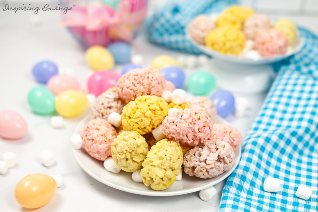 Easter Rice Krispies Egg Treats on white dinner plate with blue and white checkered table cloth