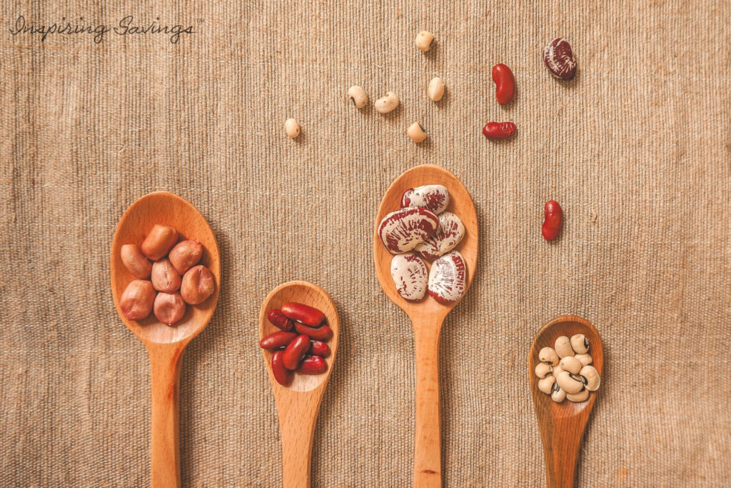 Wooden Spoons filled with beans - pantry staples