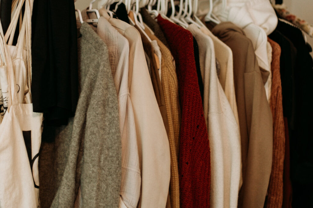 sorting through clothes closet - decluttering