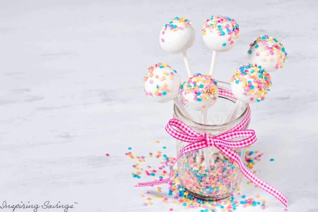 White cake pops with sprinkles in jar - Vanilla Cheesecake cake pops