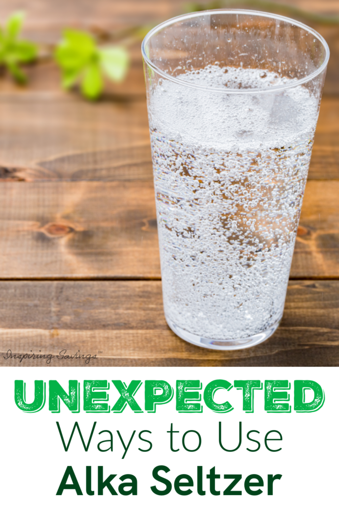 Clear glass of water with a tablet of alka seltzer on wood brown background. - Ways to use alka seltzer