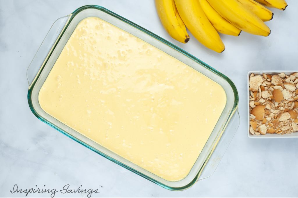 Yellow cake mix batter in glass pan. ready to be baked.