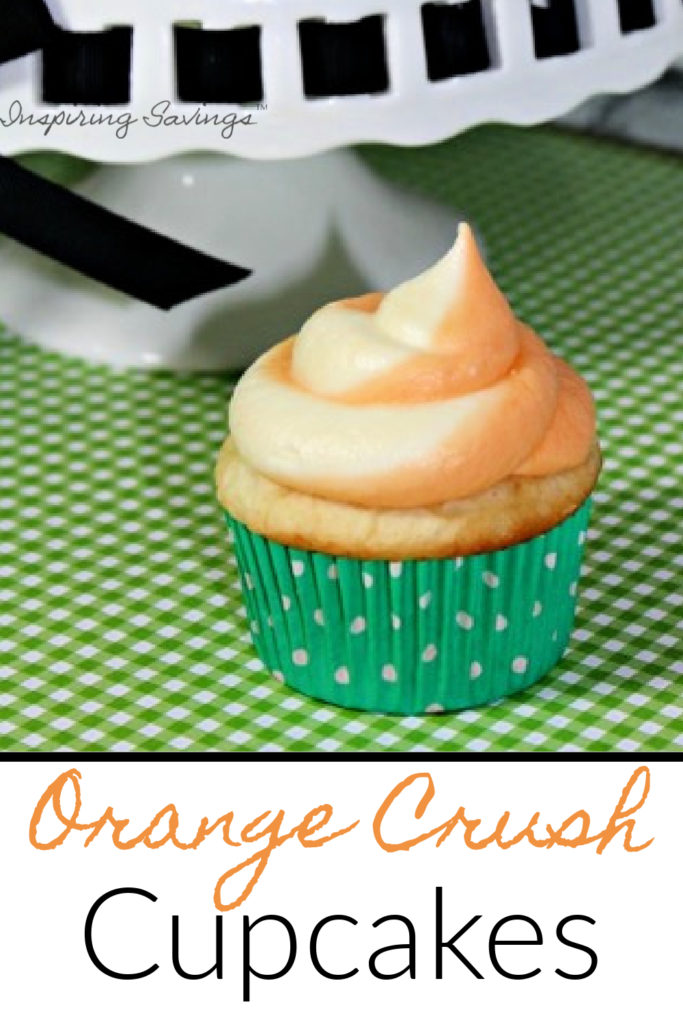 Orange Crush Cupcakes on green background next to cupcake stand