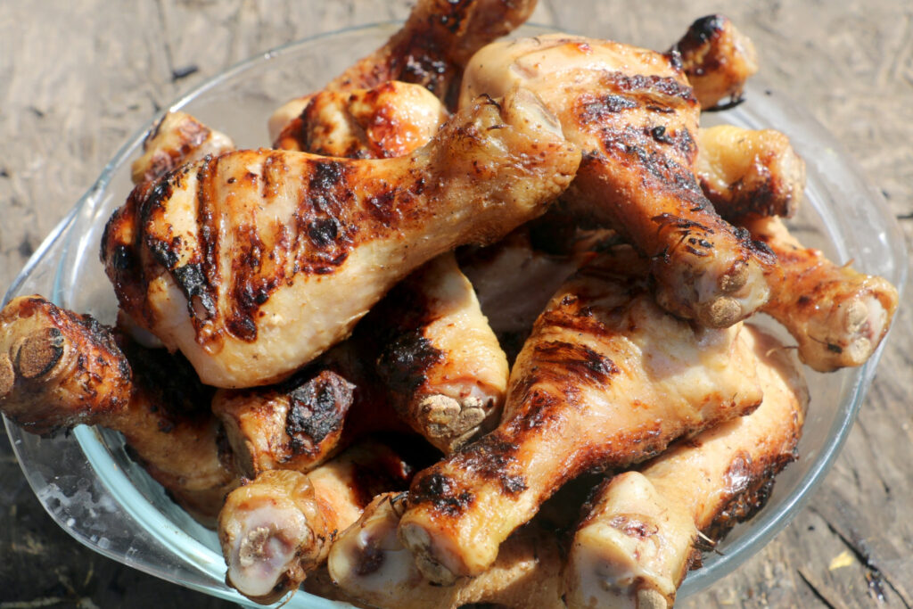 bone in chicken drumsticks cooked on plate