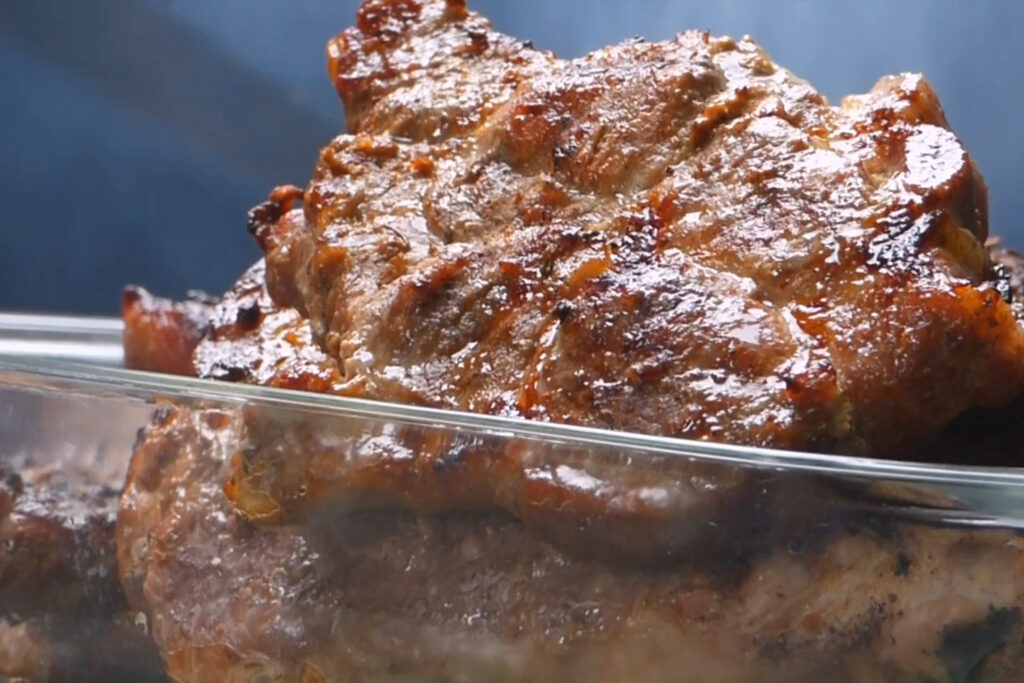 Pork chops assorted in glass pan - saving money on meat