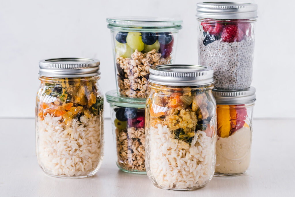 Jars of food prepped for the week - meal planning system