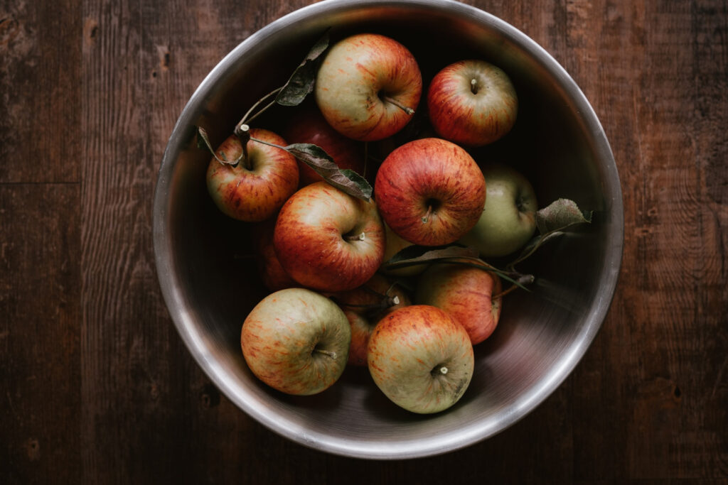 Freshly picked Apples in silver mixing bowl