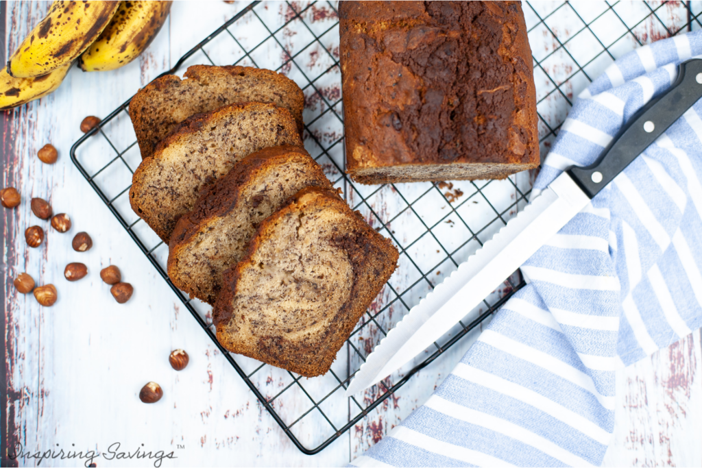 Nutella Swirl Banana Bread on cooling rack with towel